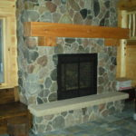 Basement ston fireplace, cedar timber mantel