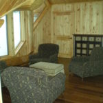 loft sitting area, pine walls, hickory floors