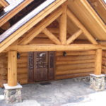 Log home entry, carved door