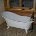 Clawfoot tub, pebble floor, master bath