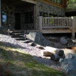 Log home decks, stone foundation