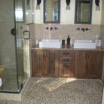 granite top vanity, pebble floor
