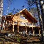 Cedar Log Lake Cabin set in hill side