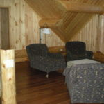 loft sitting area, logs, hickory floors