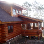 Screen porch on cedar log cabin