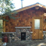 Stone and cedar Sauna building