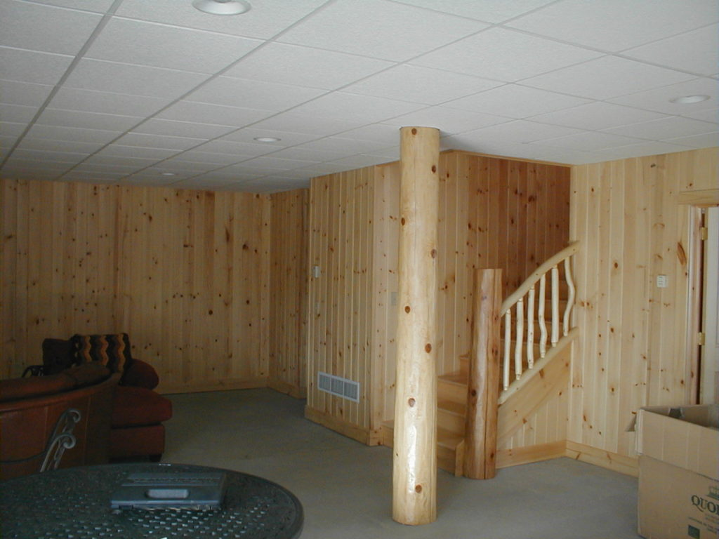 Basement stairs, pine paneled walls