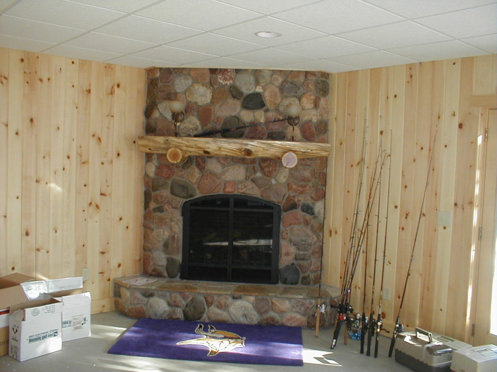 Basement stone fireplace