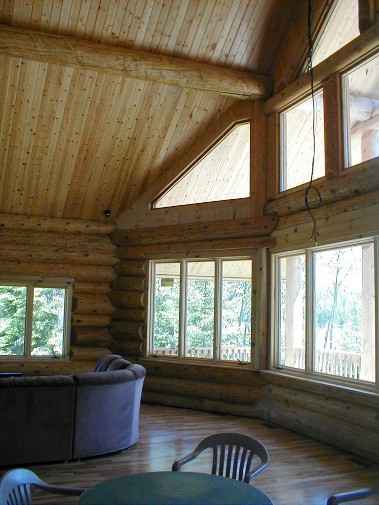 Great room lake wall cedar log home