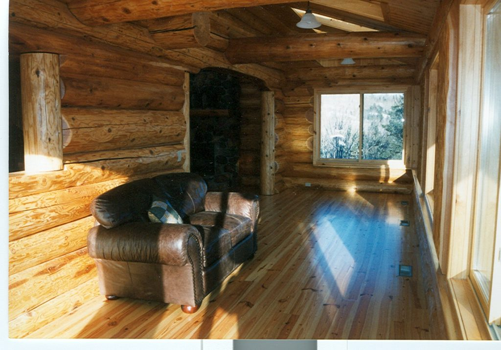 Pine floor, cedar log archway, rock fireplace