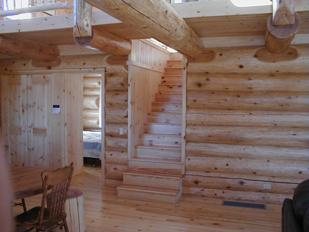 Stairs to loft, pine flooring, cedar logs