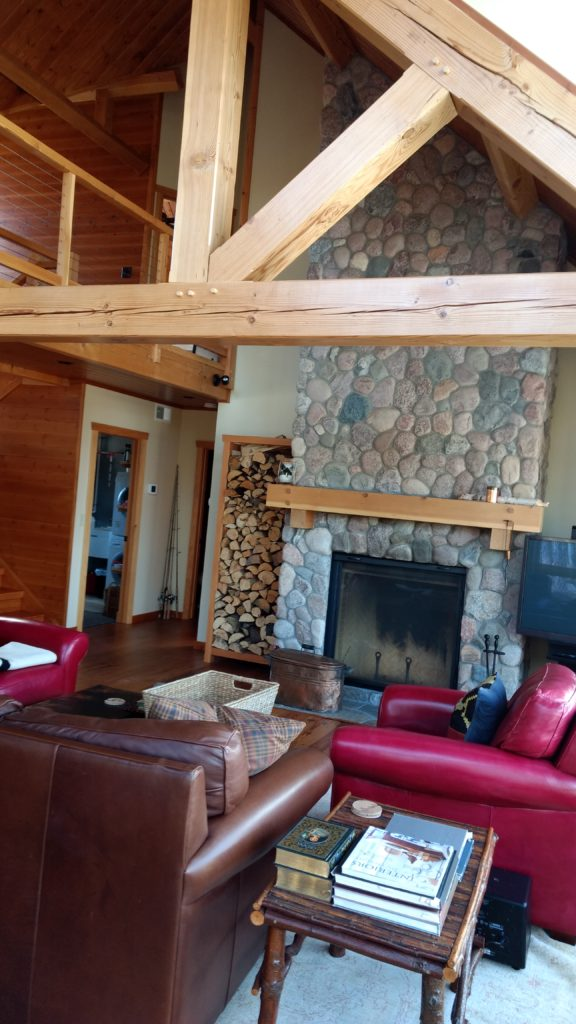 timber truss, stone fireplace