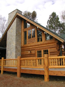 Exterior stone chimney, cedar log home