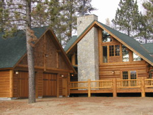 Cedar log home, exterior stone chimney