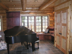Piano room, cedar log home, lots of glass