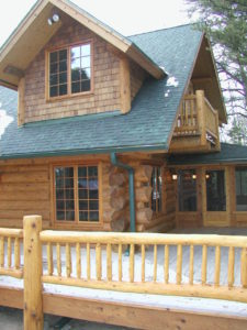 Cedar Logs and railing, dormers and screen porch
