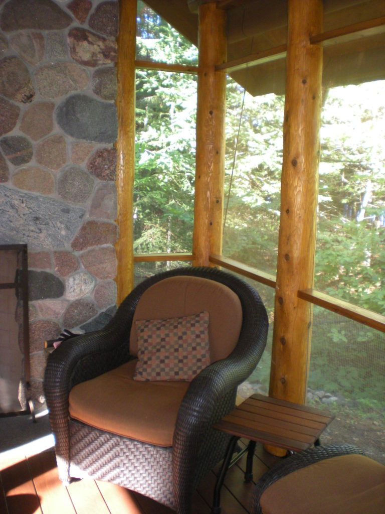 Corner chair in the log post gazebo.