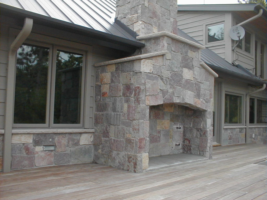Stone exterior fireplace