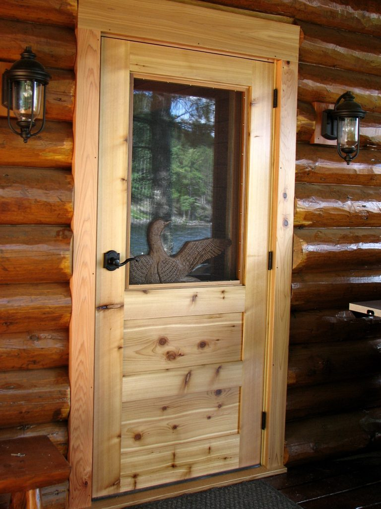 Carved loon through screen door