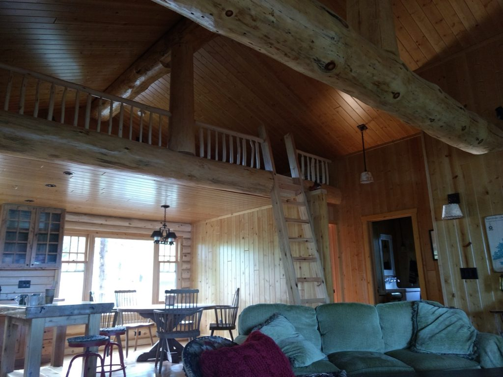 Loft and dining area inside log cabin